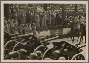 Hitler and High Command review army in parade in Warsaw after conquest of Poland.